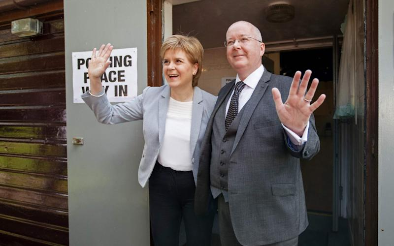 Nicola Sturgeon and Peter Murrell, who will both give evidence to the inquiry - ROBERT PERRY/AFP