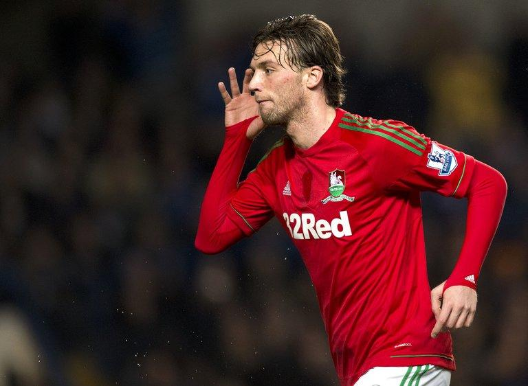 Michu scores the opening goal against Chelsea in their League Cup semi-final first leg on January 9, 2013