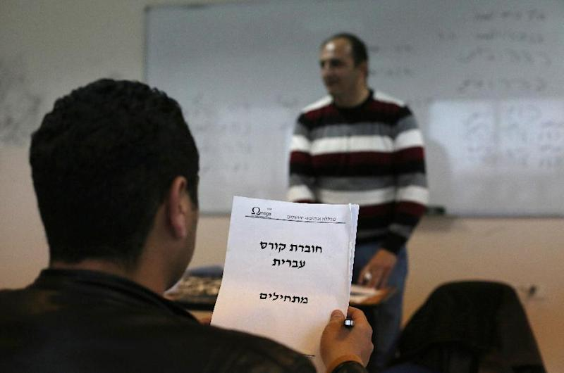 A Palestinian student attends a Hebrew language course as few journalists have official accreditation to cover events in Israel, meaning they have to rely on the Israeli or international press (AFP Photo/Abbas Momani)