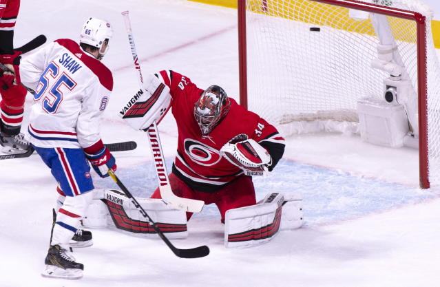 Montreal Canadiens' Andrew Shaw watches the puck go into the net past Carolina Hurricanes goaltender Petr Mrazek on a goal by Canadiens' Jeff Petry during the second period of an NHL hockey game, Thursday, Dec. 13, 2018 in Montreal. (Paul Chiasson/The Canadian Press via AP)