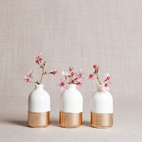 <p>You can't go wrong with these stunning <span>White and Gold Porcelain Bud Vases Set of Three</span> ($40). They'll look great in any room.</p>