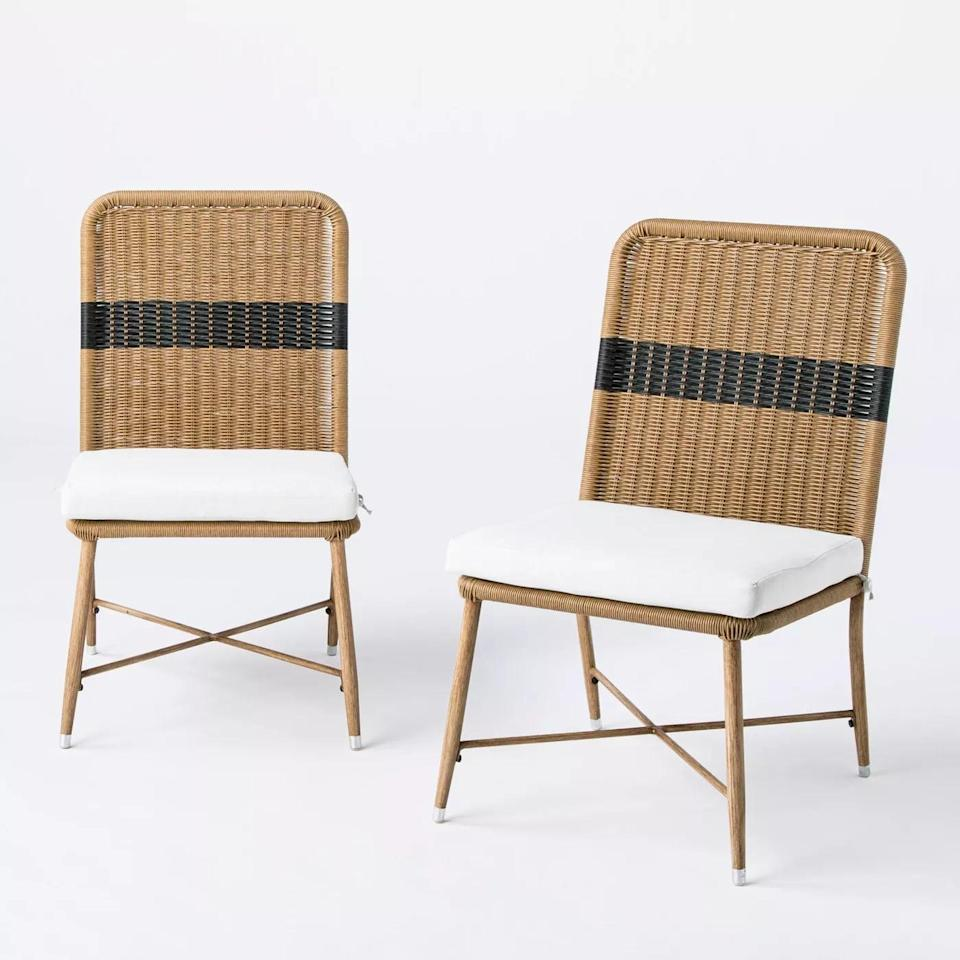 <p>We adore the black stripe on the back of the <span>Wicker and Metal Patio Dining Chairs</span> ($300).</p>