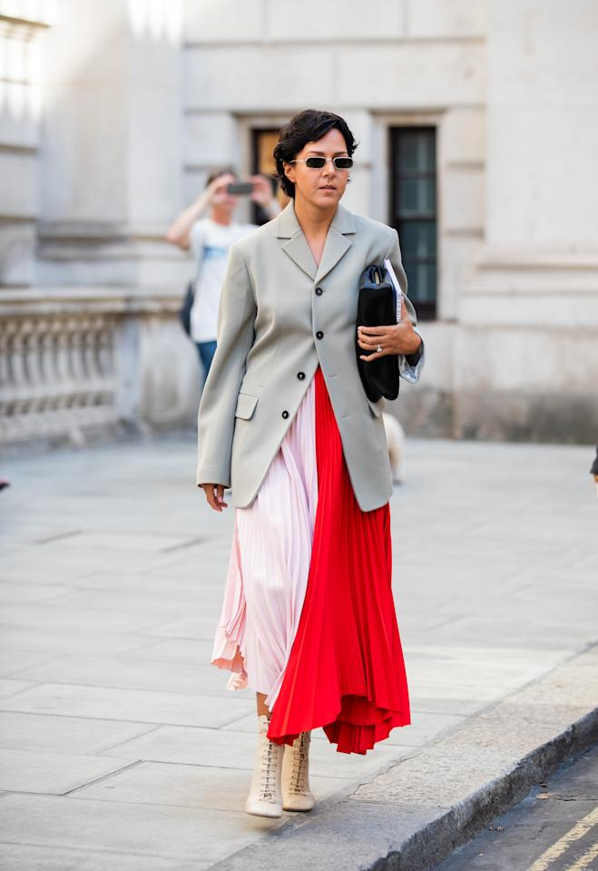 A guest is seen wearing red pink two tone skirt outside Victoria Beckham. [Photo: Getty Images]