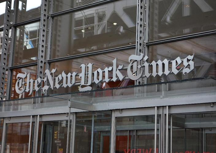 The New York Times and Spotify new subscription service will cost users $5 a week in the US (AFP Photo/DON EMMERT)