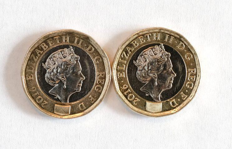 Two of the new £1 coins, including one given as change to Roy Wright, which he believes may be fake on the left (SWNS)