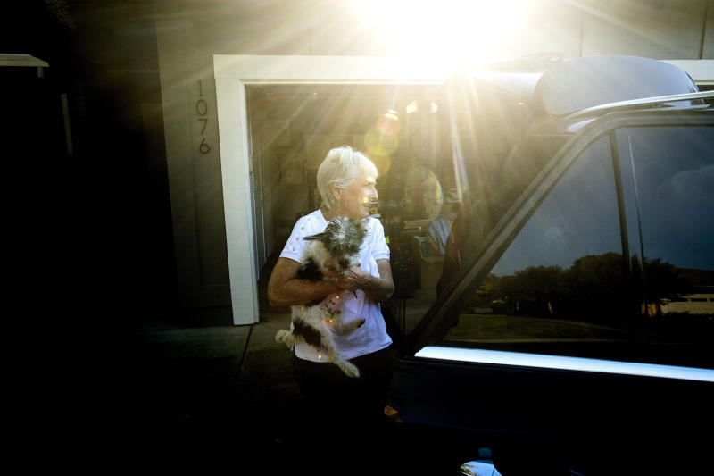 Barbara Sereni helps a neighbor evacuate her dog as a wildfire called the Kincade Fire burns nearby on Saturday, Oct. 26, 2019, in Healdsburg, Calif. (AP Photo/Noah Berger)