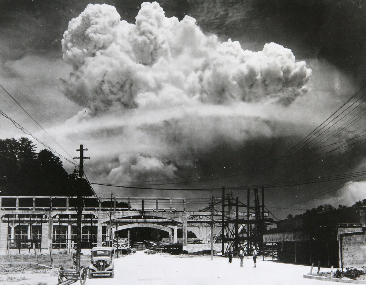 <p>View of the radioactive plume from the bomb dropped on Nagasaki City, as seen from 9.6 km away, in Koyagi-jima, Japan, Aug. 9, 1945. The U.S. B-29 superfortress Bockscar dropped the atomic bomb nicknamed 'Fat Man,' which detonated above the ground, on northern part of Nagasaki City just after 11am. (Photo: Hiromichi Matsuda/Handout from Nagasaki Atomic Bomb Museum/Getty Images) </p>