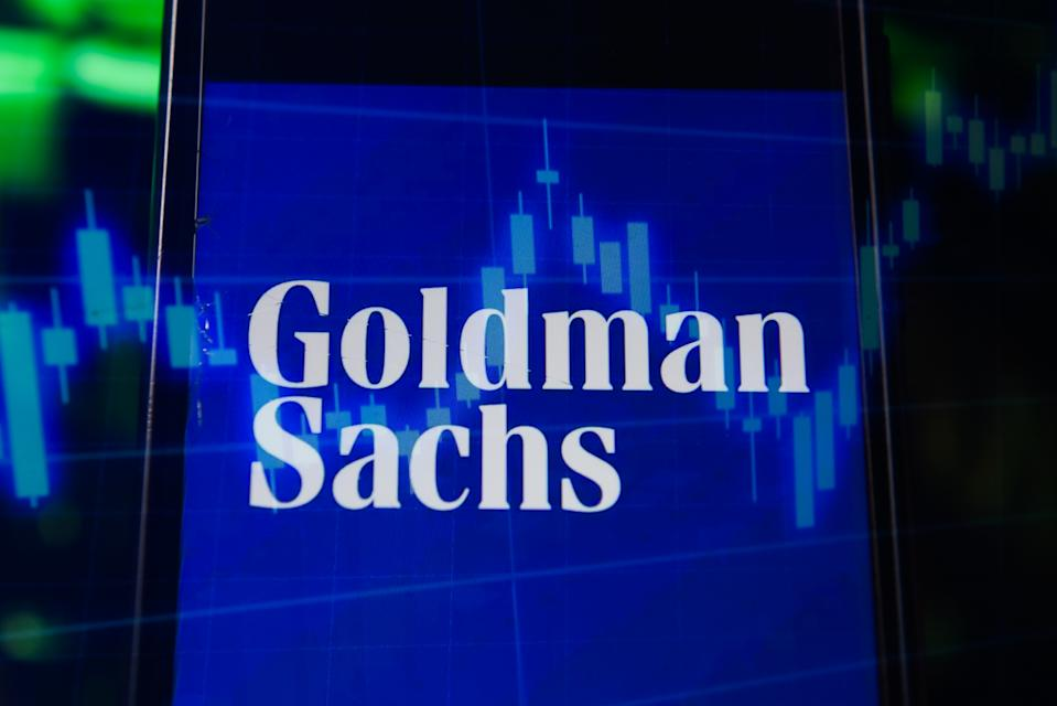 In this photo illustration a multiple exposure image shows a Goldman Sachs logo