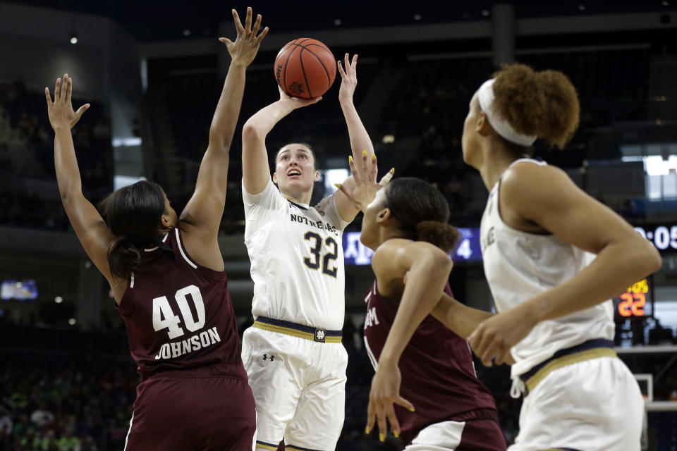 Notre Dame's Jessica Shepard (32) shoots over Texas A&M's Ciera Johnson (40) during the first half of a regional semifinal game in the NCAA women's college basketball tournament, Saturday, March 30, 2019, in Chicago. (AP Photo/Kiichiro Sato)