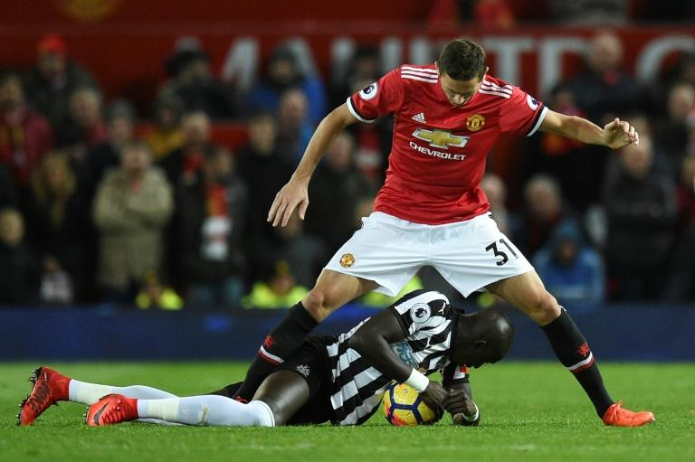 Newcastle's Mohamed Diame goes to ground in front of Manchester United's Nemanja Matic