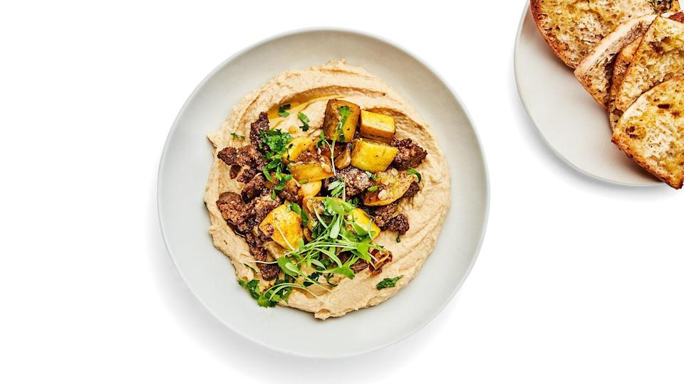"""If you're making this hummus recipe for a finicky crowd, serve all the toppings in separate bowls and let people help themselves. Lots of toasted pita for scooping up everything is nonnegotiable. <a href=""""https://www.epicurious.com/recipes/food/views/hummus-bowls-with-spiced-summer-squash-and-ground-lamb?mbid=synd_yahoo_rss"""" rel=""""nofollow noopener"""" target=""""_blank"""" data-ylk=""""slk:See recipe."""" class=""""link rapid-noclick-resp"""">See recipe.</a>"""