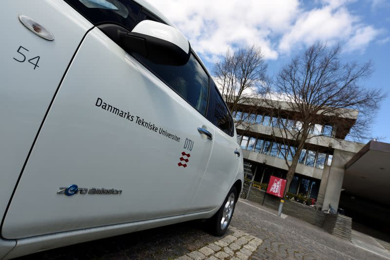 An E-car is seen in front of the main building of the Technical University of Denmark in Copenhagen