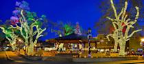 """<p>Celebrating the <a href=""""https://taos.org/events/festivals/yuletide-in-taos/"""" rel=""""nofollow noopener"""" target=""""_blank"""" data-ylk=""""slk:Yuletide in Taos"""" class=""""link rapid-noclick-resp"""">Yuletide in Taos</a> is a must-do for history buffs and Christmas-lovers alike. The small town in New Mexico holds typical tree-lighting ceremonies, concerts, and craft fairs, but come Dec. 24 it's a whole new ballgame. Taos Pueblo, the Native American settlement outside of town, hosts a procession complete with massive bonfires, rifle salutes from the settlement's rooftops, and <em>luminarias</em> (small paper lanterns). </p>"""
