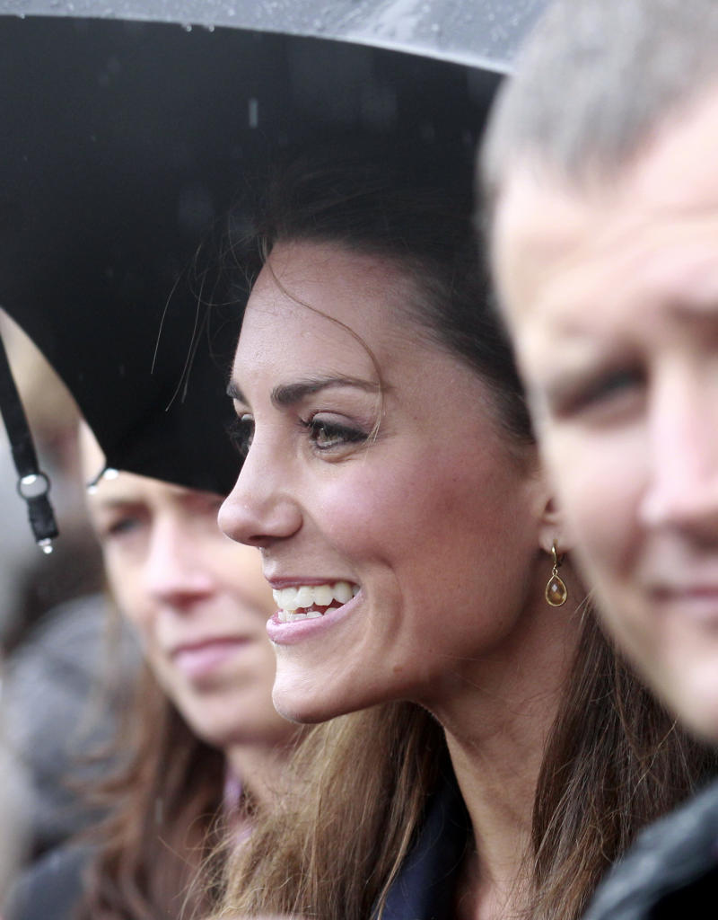 Kate Middleton smiles after attending the opening of the Darwen Aldridge Community Academy with her future husband Prince William, in Darwen, England, Monday, April 11, 2011.  Prince William and fiancee Kate Middleton visited northwest England on Monday to support local youth charities _ the last trip in their pre-wedding tour of England, Scotland, Wales and Northern Ireland. (AP Photo/Jon Super).
