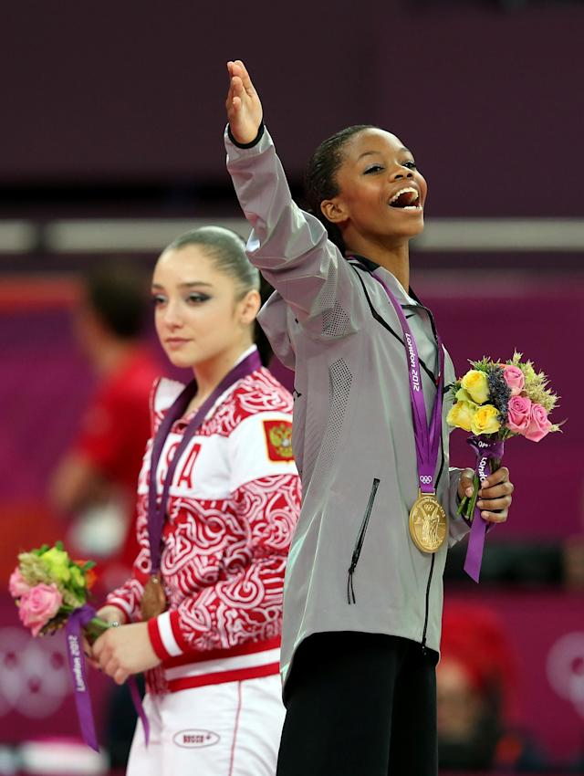 Gabrielle Douglas of the United States celebrates on the podium after winning the gold medal in the Artistic Gymnastics Women's Individual All-Around final on Day 6 of the London 2012 Olympic Games at North Greenwich Arena on August 2, 2012 in London, England. (Photo by Julian Finney/Getty Images)