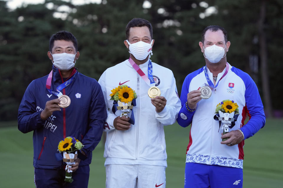 Xander Schauffele, of the United States, poses with his gold medal next to bronze medal winner C.T. Pan of Taiwan, left, and silver medal winner Rory Sabbatini, of Slovakia, right, for the men's golf at the 2020 Summer Olympics on Sunday, Aug. 1, 2021, in Kawagoe, Japan. (AP Photo/Andy Wong)
