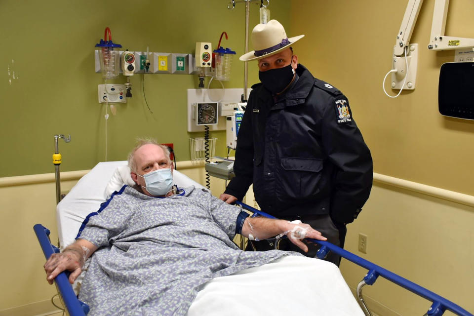CORRECTS CITY TO OWEGO, N.Y. This photo, provided by the New York State Police, shows Kevin Kresen, 58, of Candor, NY, and New York State Police Sgt, Jason Cawley, in Lourdes Hospital, in Binghamton, NY. Cawley rescued Kresen from his car, in Owego, NY, where he was stranded for 10 hours, covered by nearly 4 feet of snow thrown by a plow during this week's storm. (New York State Police via AP)