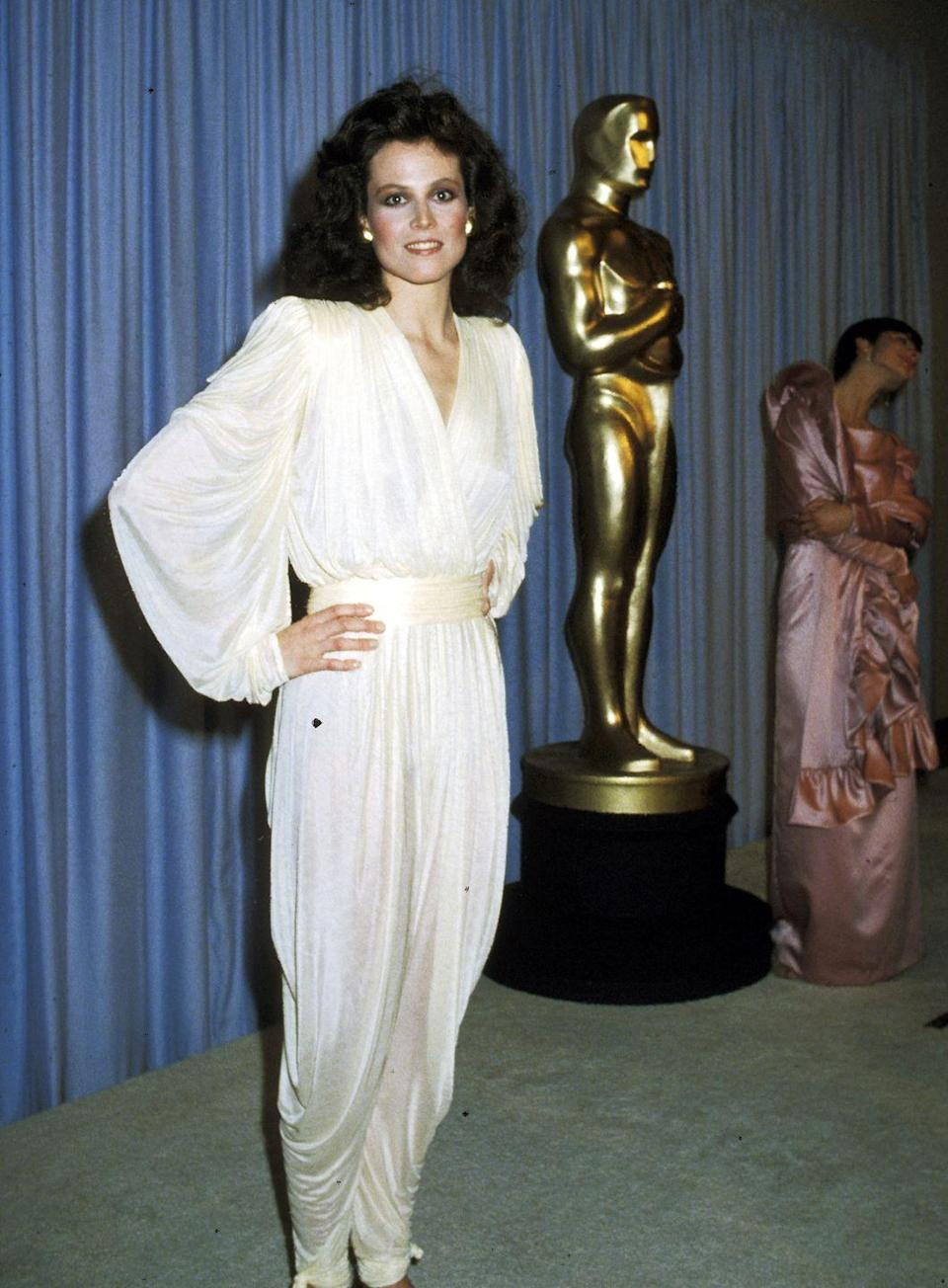 <p>Comfort... but make it fashion. Sigourney's flowy white jumpsuit and understated brown flats stole the show at that year's ceremony where she presented the award for Best Costume Design. </p>