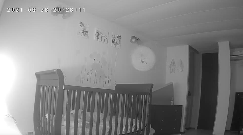The white circle can be seen on the baby monitor hovering near the child's crib. Source: Jam Press/Australscope
