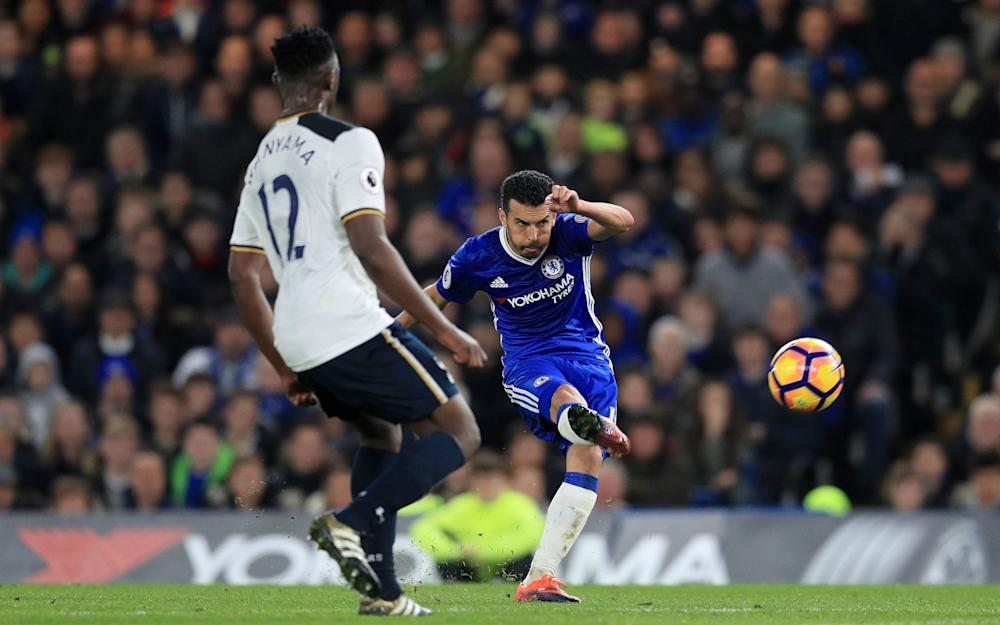 Chelsea's Pedro (right) scores his side's first goal of the game during the Premier League match at Stamford Bridge - Credit: PA