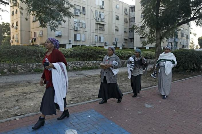 Women of the Ethiopian Jewish community walk in the central Israeli city of Rehovot (AFP Photo/MENAHEM KAHANA)
