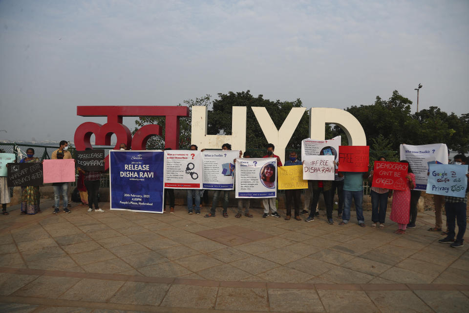 Activists participate in a silent protest against the arrest of environmental activist Disha Ravi in Hyderabad, India, Saturday, Feb. 20, 2021. The 22-year-old Indian climate activist who is facing sedition charges for her alleged role in the creation of an online document intended to help amplify farmer protests did not get bail Saturday after a court said it will reserve its order for next week. (AP Photo/Mahesh Kumar A.)