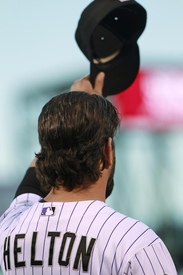 Colorado Rockies first baseman Todd Helton tips his hat to the crowd during a ceremony before the Rockies' season home finale, against the Boston Red Sox in Denver on Wednesday, Sept. 25, 2013. Helton will retire at season's end after 17 years at first base for the Rockies. (AP Photo/David Zalubowski)