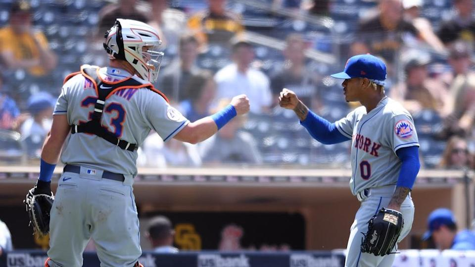 Jun 6, 2021; San Diego, California, USA; New York Mets starting pitcher Marcus Stroman (0) and catcher James McCann (33) celebrate after a double play to end the fourth inning at Petco Park. Mandatory Credit: Orlando Ramirez-USA TODAY Sports
