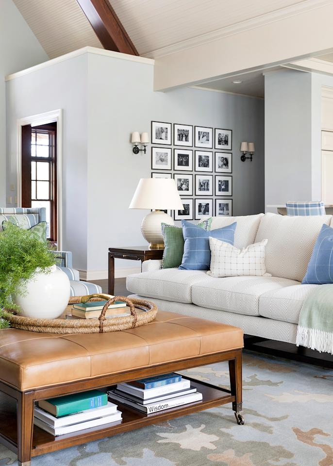 "<p>Since the home has an eclectic mix of furniture and shades of color that add depth and character to the space, Hammel went with the same <a href=""https://www.benjaminmoore.com/en-us/color-overview/find-your-color/color/hc-169/coventry-gray"">""Coventry Grey"" by Benjamin Moore</a> paint on all the <a href=""https://www.marthastewart.com/1536443/best-paint-colors-living-room-2019"">wall space throughout the entire first floor</a> to make it feel connected from room-to-room. ""We used the same paint color for the walls and the same color for all the cabinetry throughout the entire floor which tied everything together to make it cohesive and fresh,"" she says.</p>"