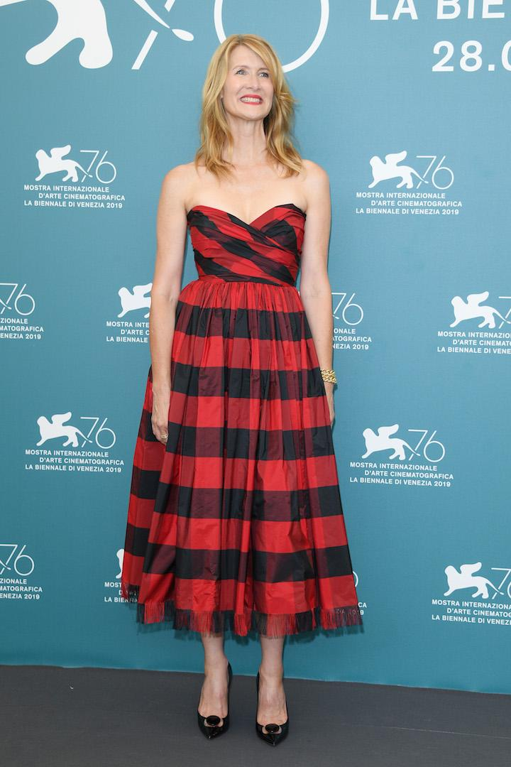 Laura Dern inspired us to start shopping for our winter wardrobe at the photo call for 'Marriage Story' in a tartan cold-shoulder frock. <em>[Photo: Getty]</em>