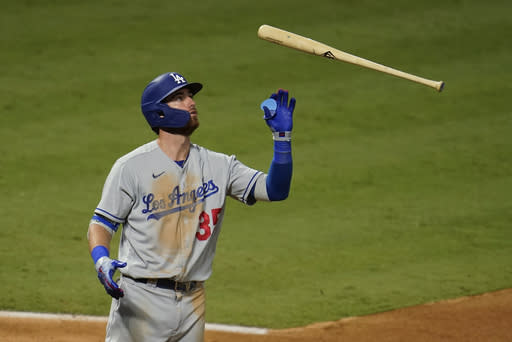 Los Angeles Dodgers' Cody Bellinger flips his bat after hitting a foul ball during the seventh inning of the team's baseball game against the Los Angeles Angels on Saturday, Aug. 15, 2020, in Anaheim, Calif. (AP Photo/Marcio Jose Sanchez)