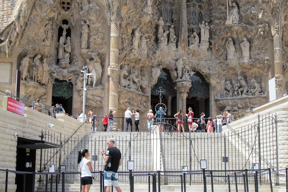 BARCELONA, July 5, 2020  -- People visit the Sagrada Familia basilica on the day of its reopening in Barcelona, Spain, July 4, 2020. One of Spain's most famous landmarks, Sagrada Familia basilica in Barcelona, opened its doors to visitors on Saturday for the first time since Spain was placed under lockdown on March 14 due to the coronavirus pandemic.     During the first phase of its reopening, access to the building is given only to healthcare workers, police officers, security and social workers and those who work for charity organizations, as well as those who ensured the supply of vital goods and services during the worst time of the coronavirus crisis. (Photo by Ismael Peracaula/Xinhua via Getty) (Xinhua/ via Getty Images)