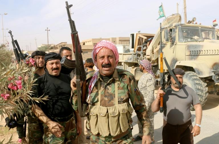 Iraqi pro-government forces gather in Rawa on November 18, 2017, after troops retook the Euphrates valley town from Islamic State group jihadists
