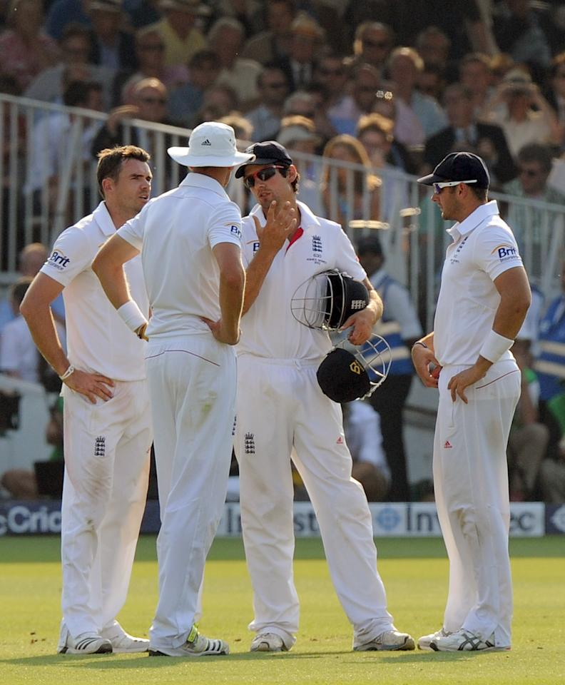 England's captain Alastair Cook (centre) speaks with bowlers James Anderson (left), Stuart Broad (second left) and Tim Bresnan (right) on day four of the Second Investec Ashes Test at Lord's Cricket Ground, London.