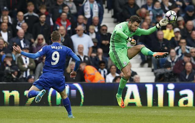<p>Leicester City's Jamie Vardy in action with West Bromwich Albion's Ben Foster </p>