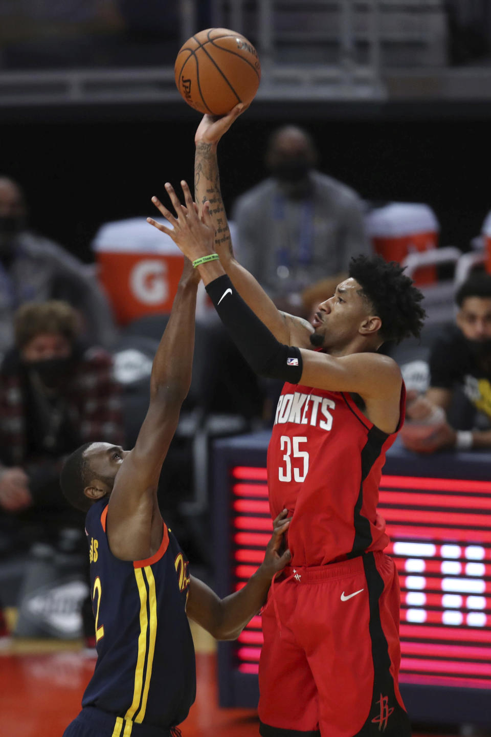 Houston Rockets center Christian Wood, right, shoots over Golden State Warriors forward Andrew Wiggins during the second half of an NBA basketball game in San Francisco, Saturday, April 10, 2021. (AP Photo/Jed Jacobsohn)