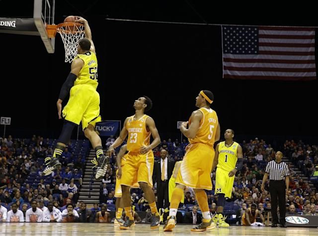 Michigan's Jordan Morgan dunks during the first half of an NCAA Midwest Regional semifinal college basketball tournament game against the Tennessee Friday, March 28, 2014, in Indianapolis. (AP Photo/David J. Phillip)