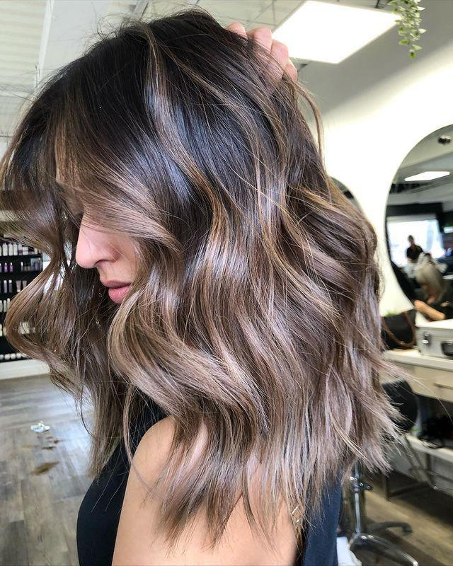 """<p>This ash-brown hair color is all about <em>shine. </em>Hot tip: One of the easiest ways to keep your color looking fresh is to <strong>(A) load up on <a href=""""https://www.cosmopolitan.com/style-beauty/beauty/g26132600/heat-protection-hair-spray/"""" rel=""""nofollow noopener"""" target=""""_blank"""" data-ylk=""""slk:protectant"""" class=""""link rapid-noclick-resp"""">protectant</a> before heat styling and (B) avoid prolonged sun exposure</strong>, says Rubel.</p><p><a href=""""https://www.instagram.com/p/CCcSJX4haqI/"""" rel=""""nofollow noopener"""" target=""""_blank"""" data-ylk=""""slk:See the original post on Instagram"""" class=""""link rapid-noclick-resp"""">See the original post on Instagram</a></p>"""