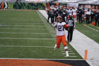 Cleveland Browns' Kareem Hunt (27) goes in for a touchdown during the second half of an NFL football game against the Cincinnati Bengals, Sunday, Oct. 25, 2020, in Cincinnati. (AP Photo/Bryan Woolston)