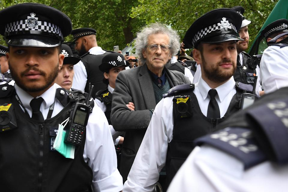 Police lead away Piers Corbyn, brother of former Labour leader Jeremy Corbyn, as protesters gather in breach of lockdown rules in Hyde Park in London after the introduction of measures to bring the country out of lockdown. (Photo by Stefan Rousseau/PA Images via Getty Images)