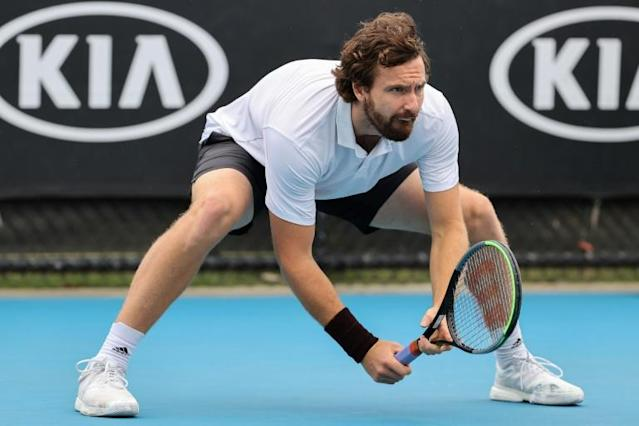 Latvia's Ernests Gulbis is running low on shoes at the Australian Open (AFP Photo/DAVID GRAY)