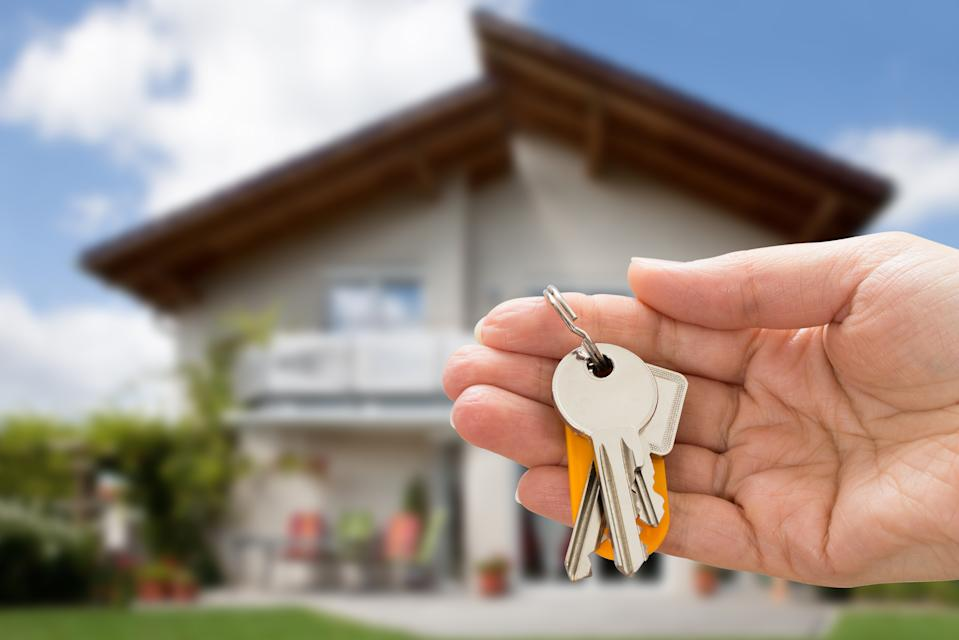 Close-up Of Person Hand Holding House Key In Hand