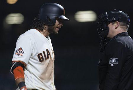 May 17, 2018; San Francisco, CA, USA; San Francisco Giants shortstop Brandon Crawford (35) reacts after a call third strike during the twelfth inning against the Colorado Rockies at AT&T Park. Mandatory Credit: Neville E. Guard-USA TODAY Sports