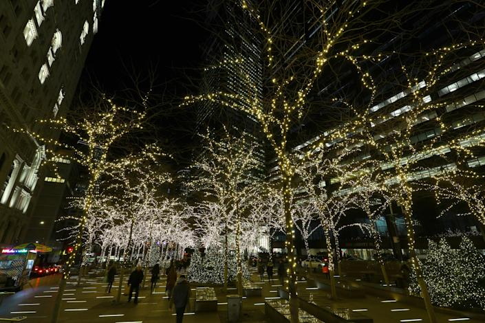 Delicate lights decorate the trees in Zuccotti Park in lower Manhattan. (Photo: Gordon Donovan/Yahoo News)