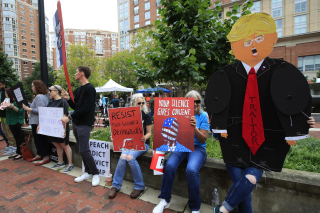 <p>Protesters hold their banners in front of the Alexandria Federal Court in Alexandria, Va., Tuesday, July 31, 2018, on day one of Paul Manafort's trial. (Photo: Manuel Balce Ceneta/AP) </p>