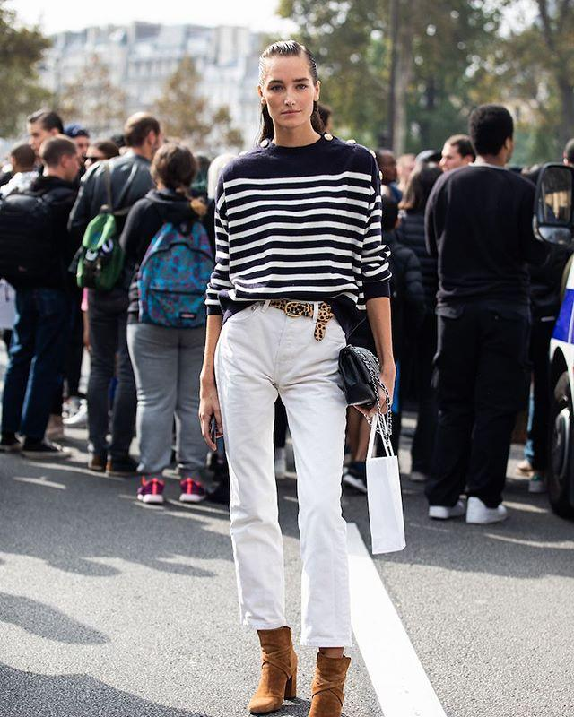 """<p>For a casual and classic ensemble, wear your favorite striped sweater with white jeans and a pair of suede booties; the variety in this look is easy to recreate for the weekend. </p><p><a href=""""https://www.instagram.com/p/BqX7r-4HUF0/"""">See the original post on Instagram</a></p>"""