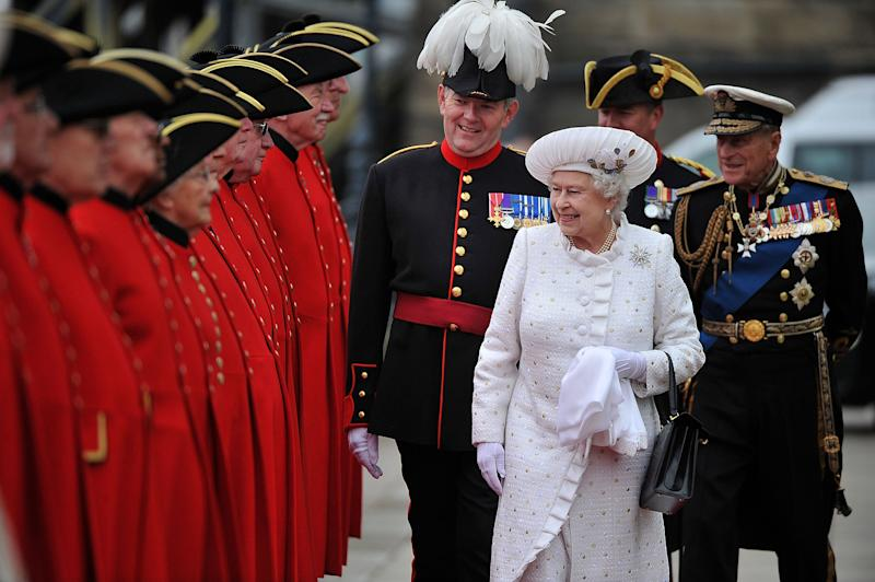 Britain's Queen Elizabeth II, centre, and Prince Philip, right, arrive at Chelsea Pier in London, before boarding the royal barge to participate in the Diamond Jubilee River Pageant Sunday June 3, 2012. More than 1,000 boats will sail down the River Thames on Sunday in a flotilla tribute to Queen Elizabeth II's 60 years on the throne that organizers are calling the biggest pageant on the river for 350 years. (AP Photo/Bethany Clarke, Pool )