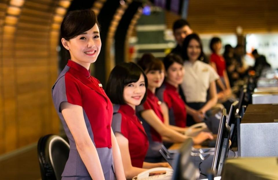 CAL ground staff at Taiwan Taoyuan Airport Check-in desks pose for a photograph. (Courtesy of China Airlines/Instagram)