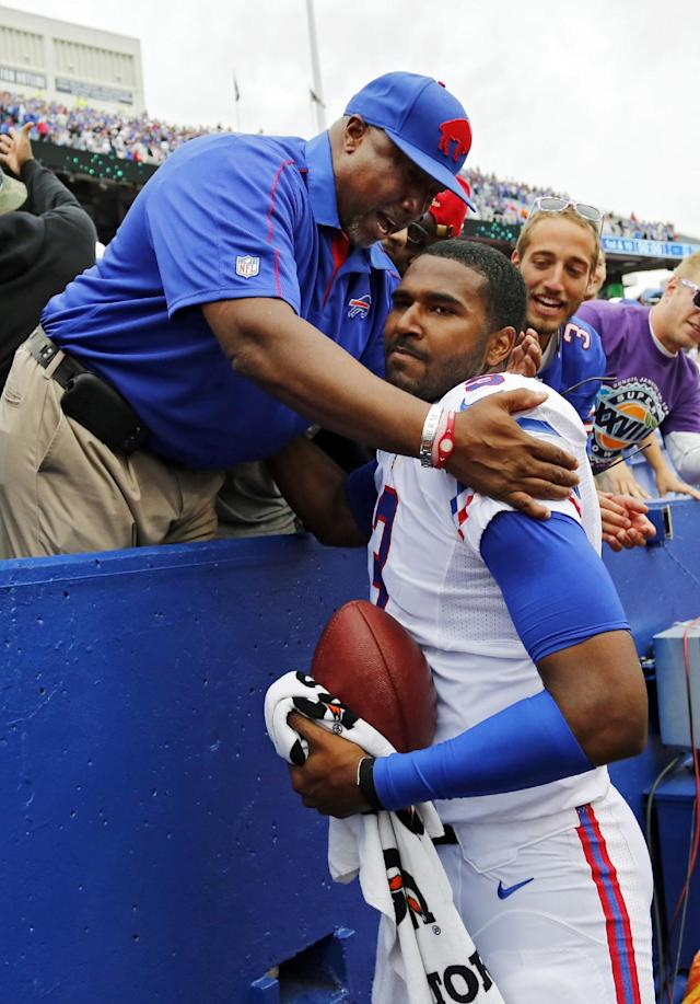 Buffalo Bills quarterback EJ Manuel, right, gets a hug from his father, Eric Manuel Sr., after a 24-23 win over the Carolina Panthers in an NFL football game Sunday, Sept. 15, 2013, in Orchard Park, N.Y. Manual's 2-yard pass with two seconds left in the game gave Manual his first win. (AP Photo/Bill Wippert)