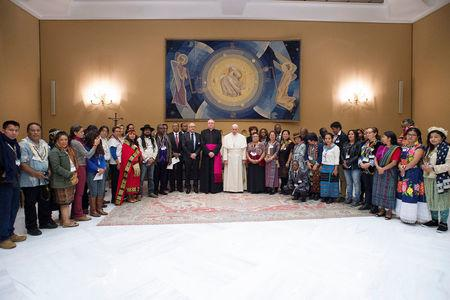 Pope Francis poses during a meeting with indigenous people to mark the 40th governing council of the the International Fund for Agricultural Development (IFAD) at the Vatican February 15, 2017. Osservatore Romano/Handout via REUTERS